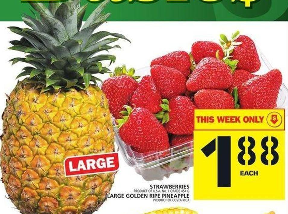 Strawberries Or Large Golden Ripe Pineapple