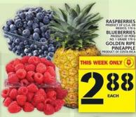 Raspberries Or Blueberries Or Golden Ripe Pineapple