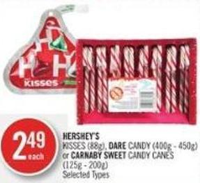 Hershey's Kisses (88g) - Dare Candy (400g - 450g) or Carnaby Sweet Candy Canes (125g - 200g)